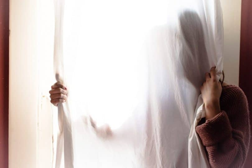 Image of a lost woman and a curtain experiencing a spiritual emergency