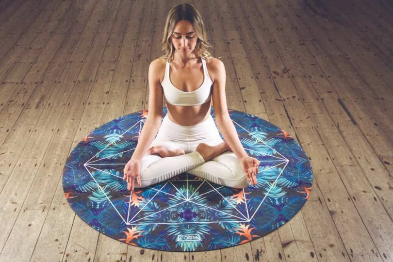Image of a trendy woman in a yoga pose symbolizing spiritual materialism