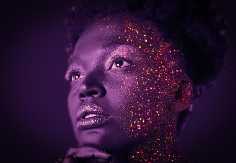 Image of a woman in purple light representing the divine feminine