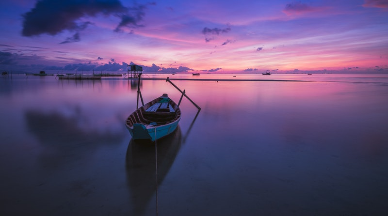 Image of a boat on a calm ocean that represents inner peace
