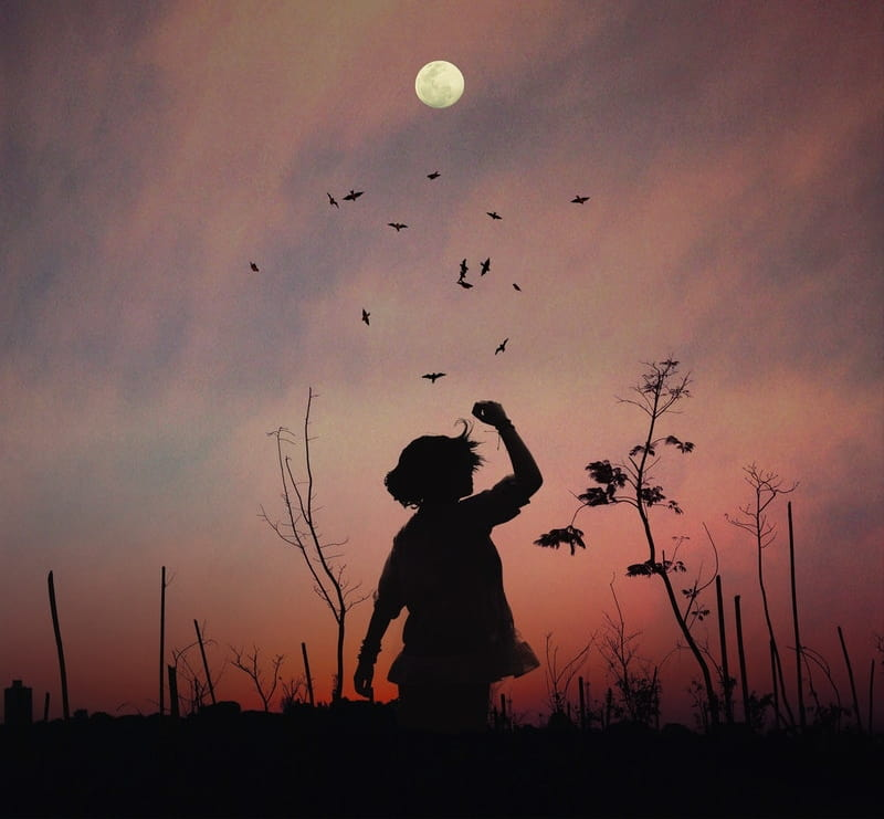 Image of a child and the moon at sunset symbolic of the mystical experience