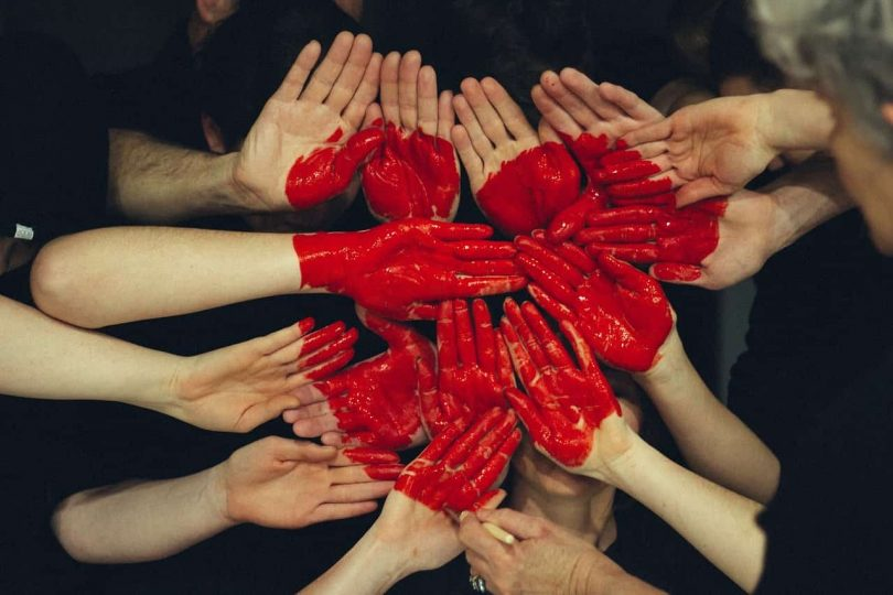 Image of a group of hands representing internal family systems therapy