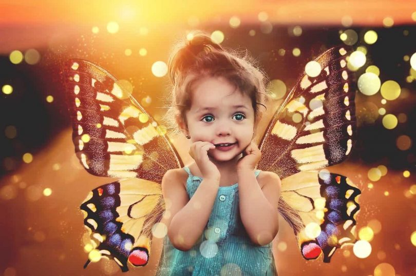 Image of a magical child with butterfly wings