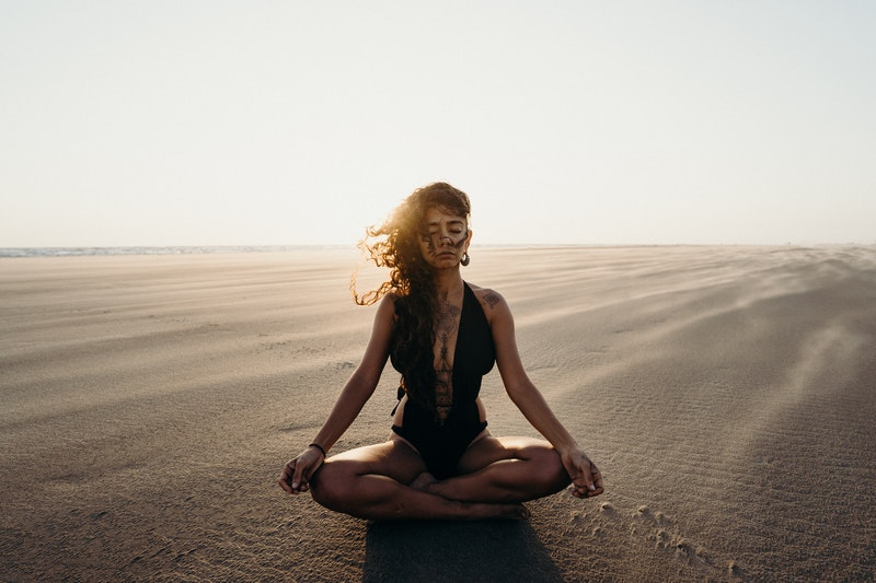 Image of a woman practicing yoga and embodied spirituality