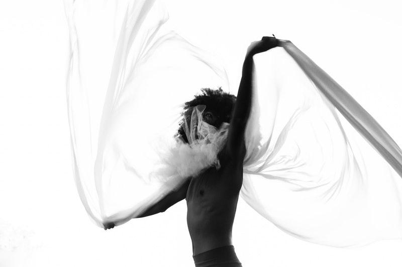 Image of a dancing man practicing breathwork