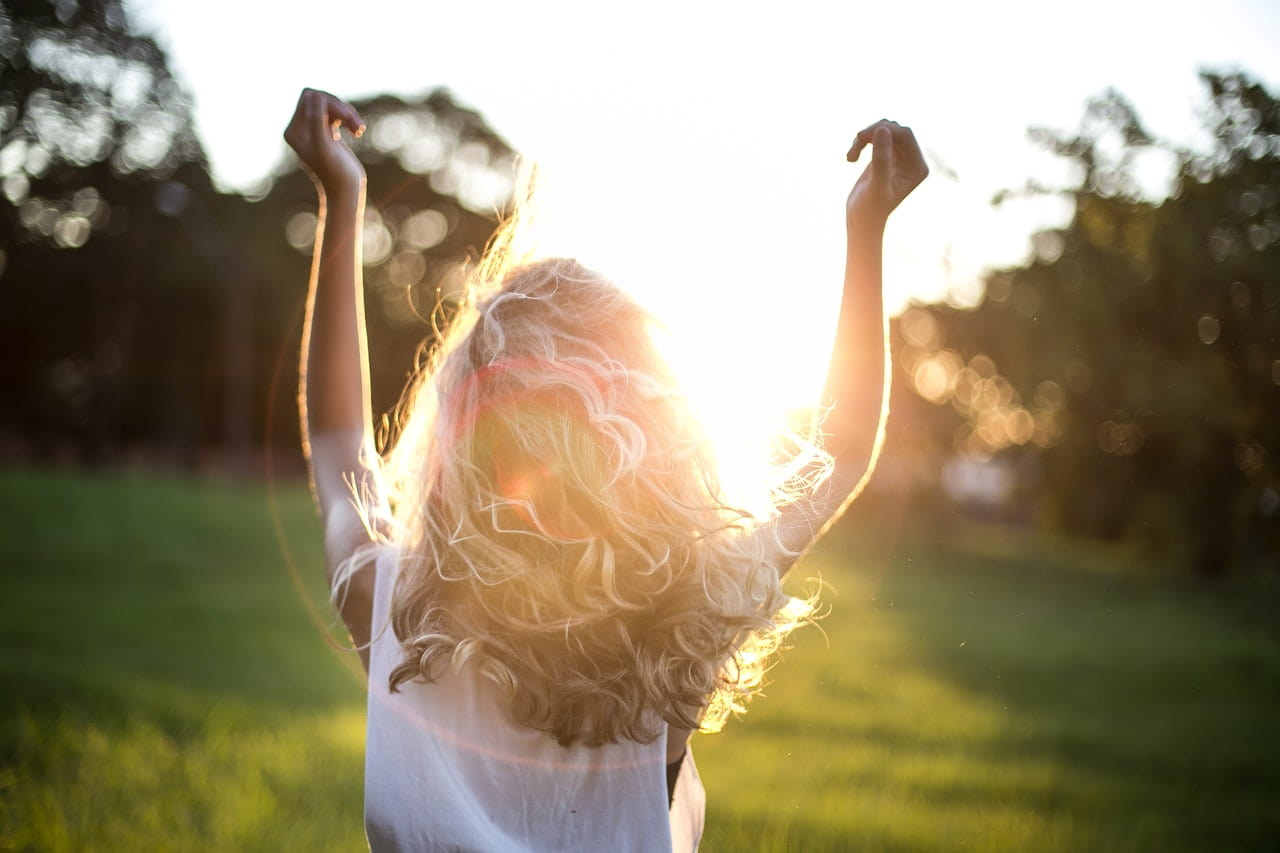 Image of a woman dancing in the sun representing embodied spirituality