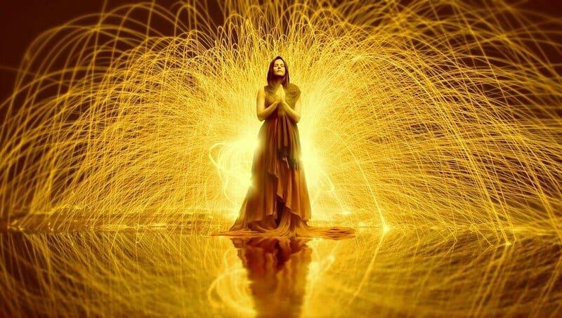 Image of a mystical woman experiencing kundalini awakening symptoms