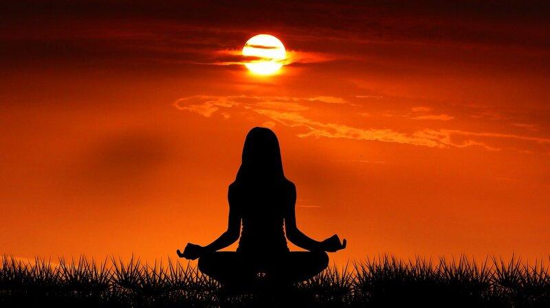 Image of a woman meditating