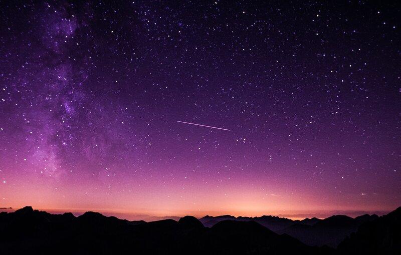 Image of a purple night sky full of stars symbolic of deep listening