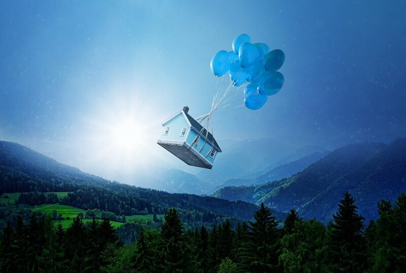 Image of a house attached to balloons flying away