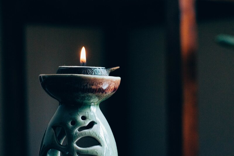 Image of an oil burner and candle