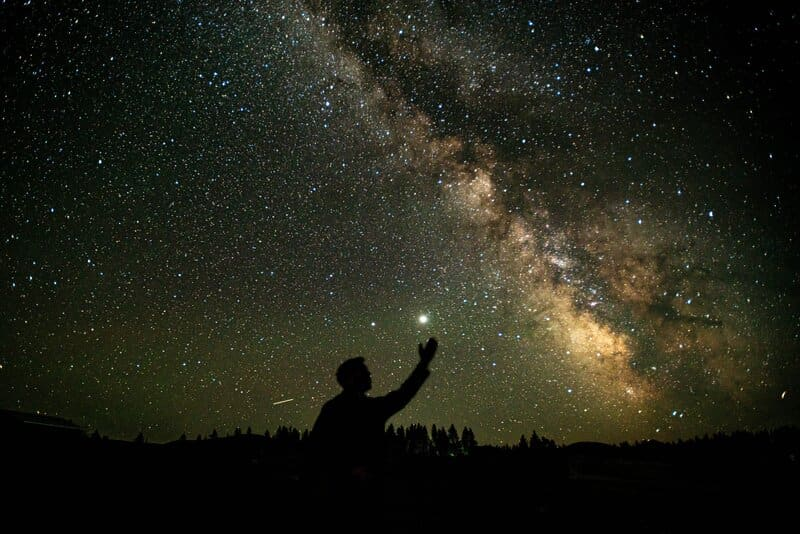 Image of a person reaching for the stars symbolic of soul retrieval